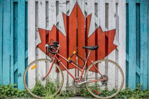 provincial legislation background - bicycle and canadian flag in background