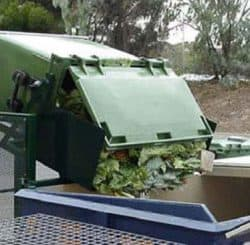 Garbage truck emptying waste